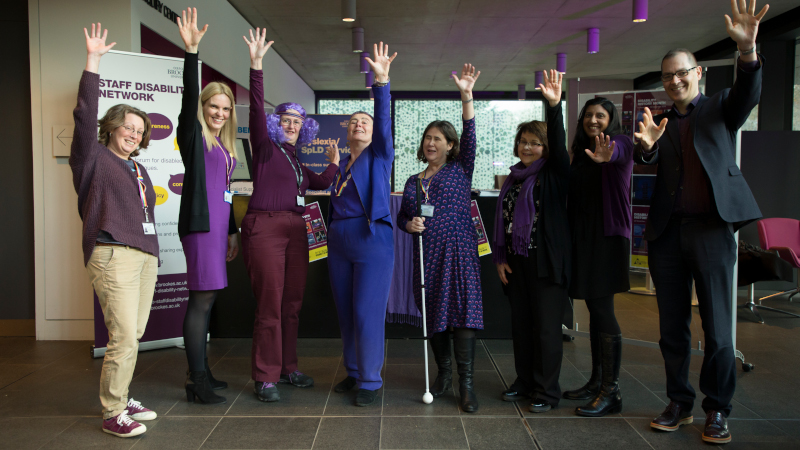 Purple Light up 3 - Vice Chancellor and staff posing