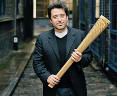 Jay Osgerby with the Olympic Torch