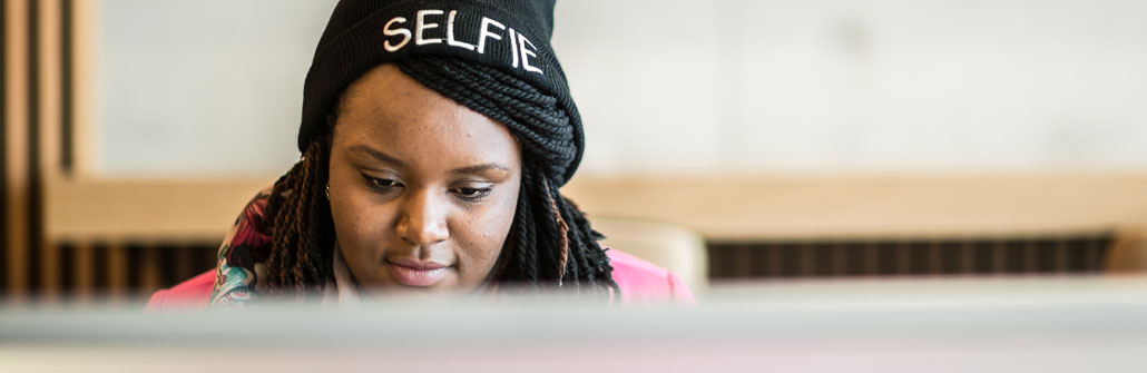 Black female student wearing woolly hat