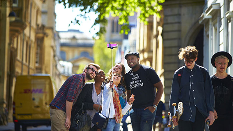 Oxford: students with a selfie stick in central Oxford