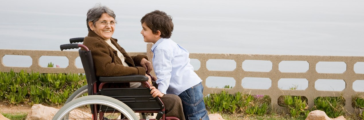 Physio and Rehab banner woman in wheelchair with young boy 1270 x 420