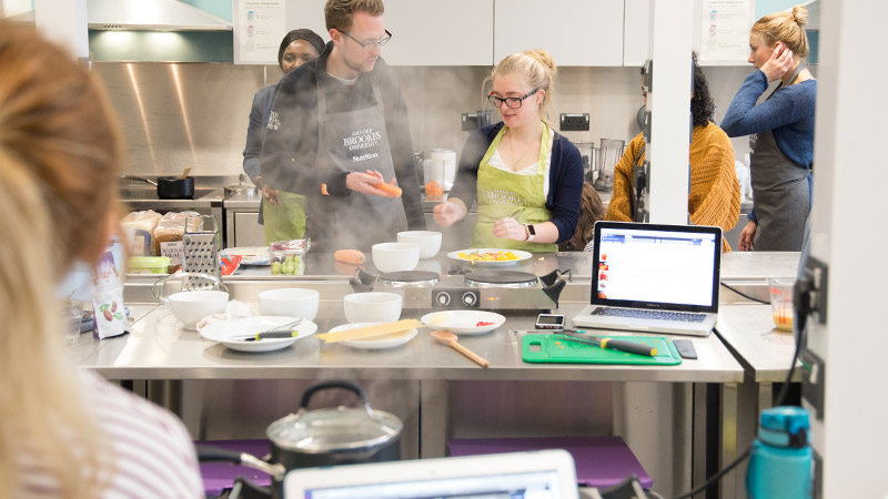 Students cooking in the nutrition kitchen