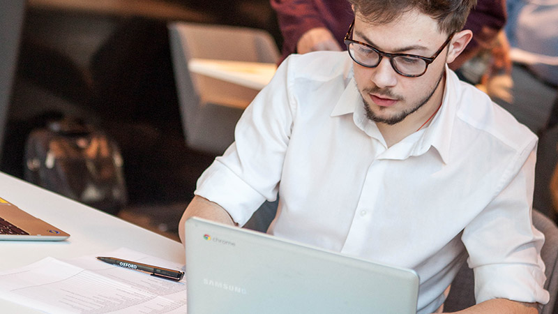 Researcher using a laptop in a quiet space