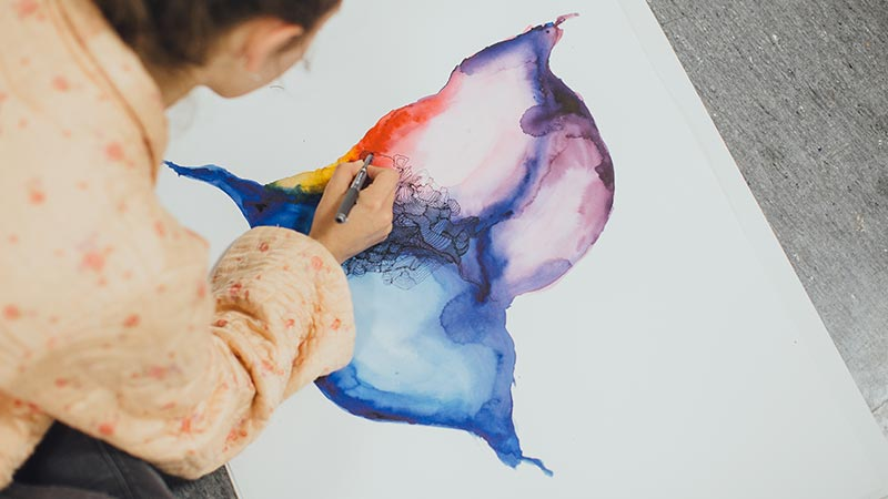 Student creating a water colour painting