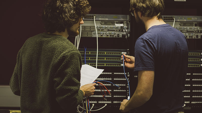 Students connecting computer wires