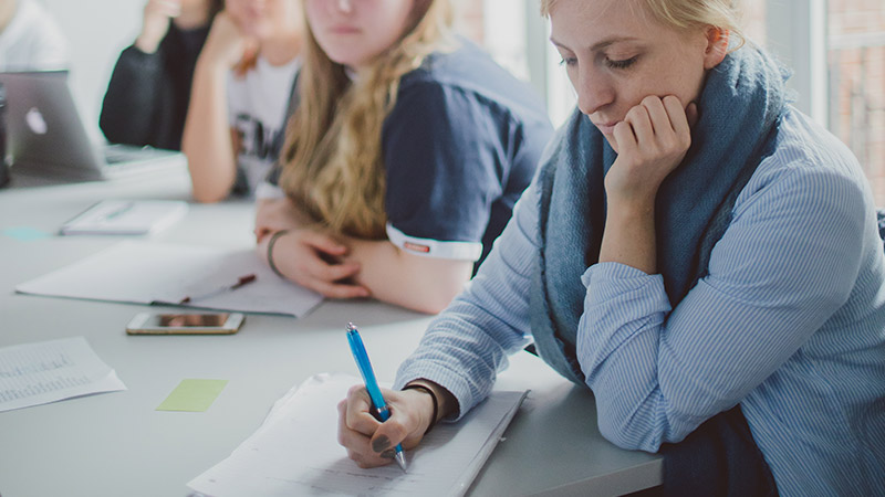 Student nurses taking notes in a lecture