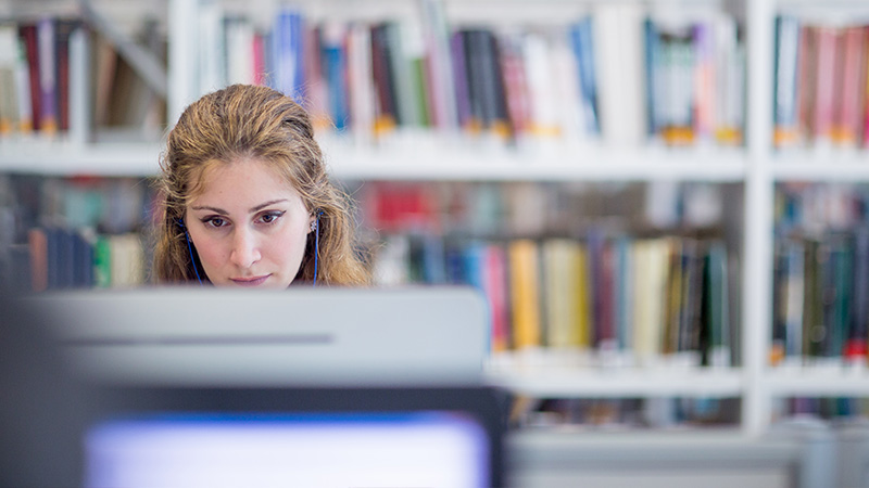 Female student working in library