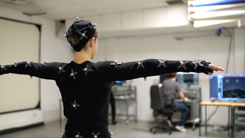 Student using motion capture equipment