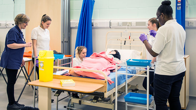 Students practicing with a simulation manikin