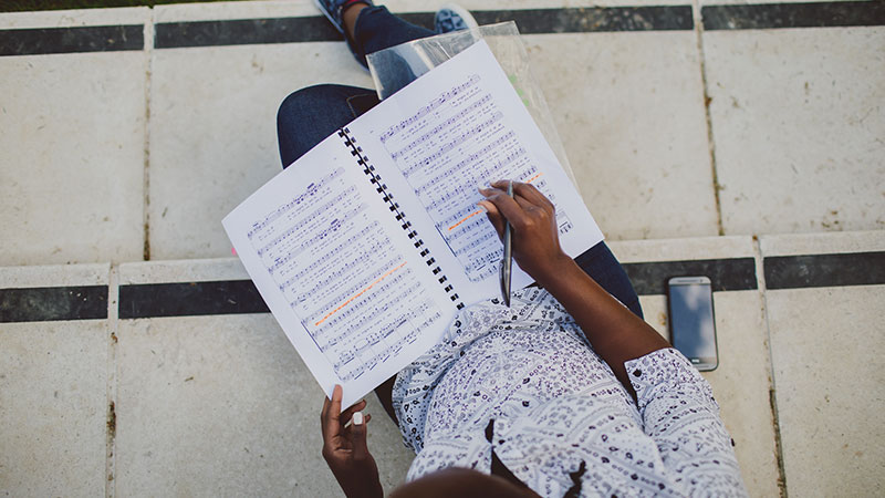 Student with music book