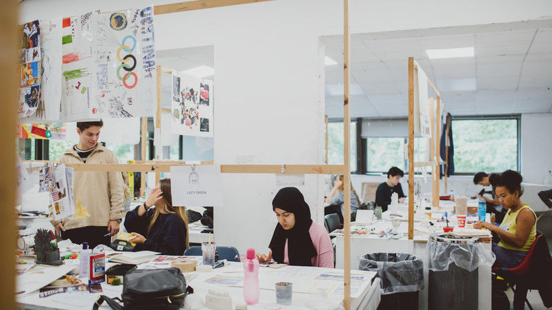 People working in a creative working space
