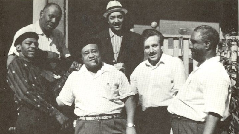 Paul Oliver with a group of blues musicians