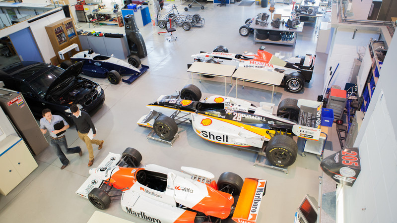 F1 cars in motorsport engineering workshop