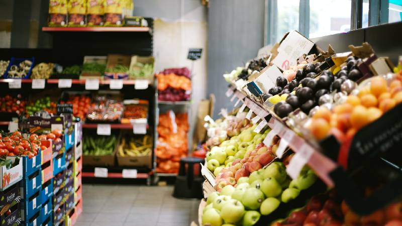 Shelves stocked with fruit and vegetables in a shop
