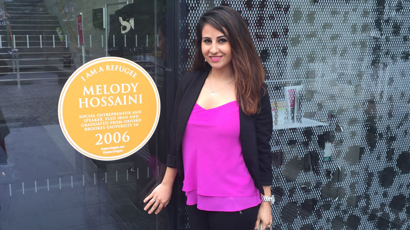 Melody Hossaini with her IAAR plaque