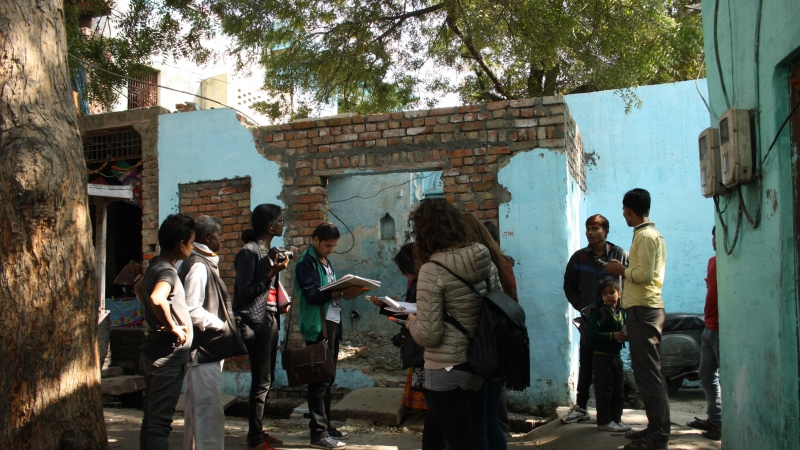 Oxford Brookes and SPA Delhi students talking to local inhabitants in a riverside neighbourhood